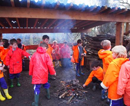 Forest school orange coats fire